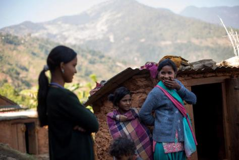 Radhika Sunar and other girls laughing outside a small hut