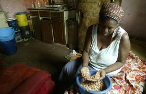 Faustine Janjira prepares food at her home in Zimbabwe suburb