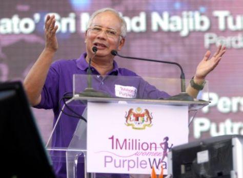 Prime Minister Datuk Seri Najib speaks at the 1 Million Women Purple Walk