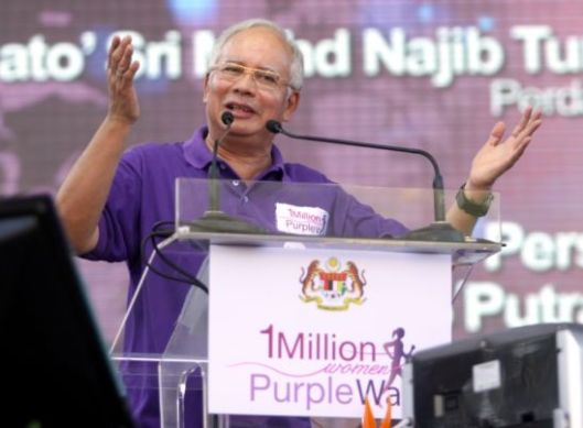 Prime Minister Datuk Seri Najib speaks at the 1 Million Women Purple Walk