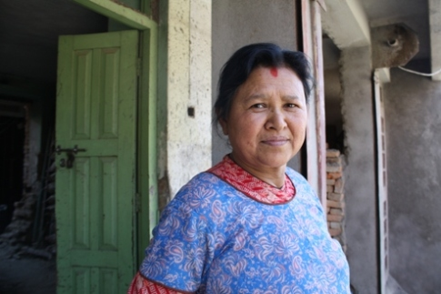 Kathmandu woman moves home away from street project