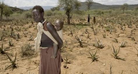 Woman with child in aloe vera field