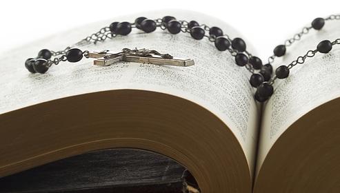 Catholic rosary and Bible