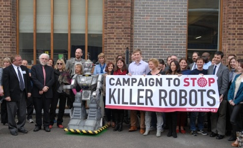 Sponsors and activists hold up banner for Campaign to Stop Killer Robots in London