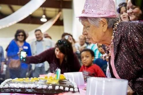 Lakota centurion Laura Galligo Brewer blows out the candles on her birthday cake