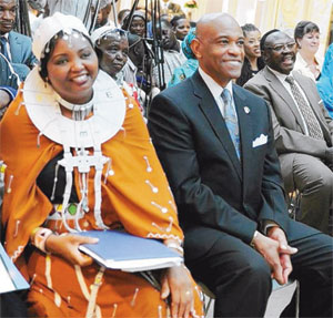 Ms Ndinini Kimesera Sikar and Ambassador Lenhardt in a jolly mood after she was declared one of the 2013 women of courage. Image: Citizen