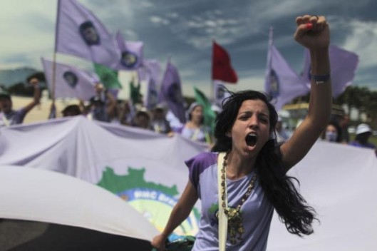 A woman protesting over violence against women shouts slogans at the close of the National Meeting of Rural Women in Brasilia February 21, 2013. Image:Ueslei Marcelino/REUTERS