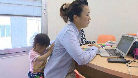 The Japanese government is trying to change the working environment for Japanese mothers in order to encourage greater participation in the workforce. (Source: TVAsahi/CNN)