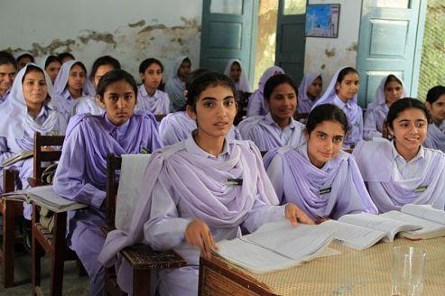 Girls study in classroom in Pakistan