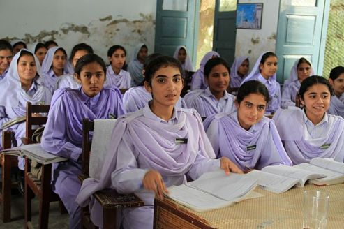 Girls study in classroom in Pakistan