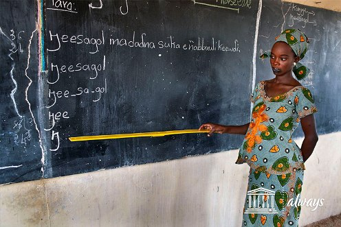 Young woman at blackboard in Senegal literacy class