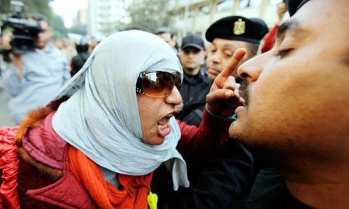 Egyptian woman protester sounds off to offensive man in Tahrir Square, Cairo
