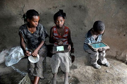 Children Ethiopia with a pc laptop and tablet