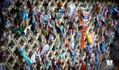 Threaded offerings tied at the shrine of Sufi saint Hamza Makhdum in the Kashmiri capital city of Srinagar.