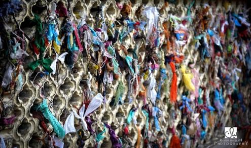Threaded offerings tied at the shrine of Sufi saint Hamza Makhdum in the Kashmiri capital city of Srinagar.