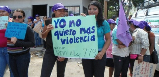women holding protest signs