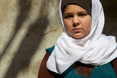 "In January 2013, an International Rescue Committee survey revealed that Syrian refugees cited rape as a primary reason their families fled the conflict. ""I chose to leave Syria because I heard that they'd attack and rape the girls, so I got worried about my daughters."" Mervat says. Haneen, Mervat's eldest daughter says ""We can't go back to Syria until the war is over"". Image: Hedinn Halldorsson/Save the Children"