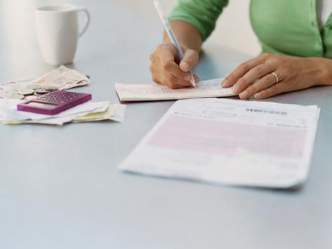 woman writing with mug