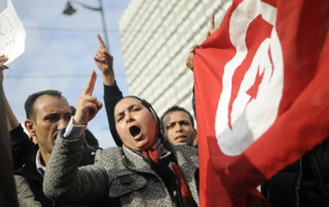 Women rally aournd a flag