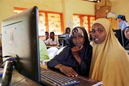 Two refugee girls learn on computers, Ifo camp, Dadaab, Somalia