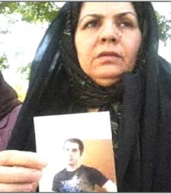 Iranian mother Zoleik Hamousavi with photo of imprisoned son