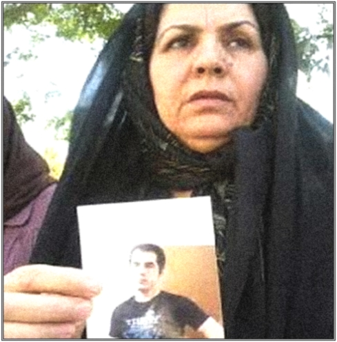 Iranian mother Zoleik Hamousavi with photo of imprisoned son
