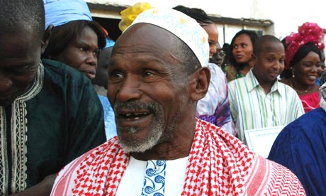 Senegalese chief and imam, Demba Diawara walks among villagers