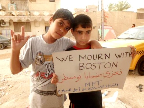 Two boys in Baghdad, Iraq stand up for peace as they send a special message shown through banner of support for those mourning the deaths and injuries that happened during the 2013 Boston Marathon bombings in the U.S.. Image: Arsalan Iftikhar/Twitpic