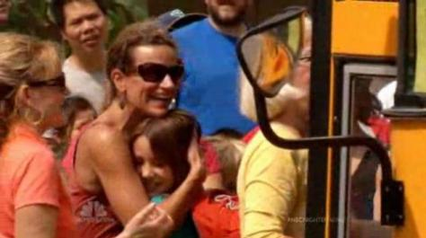 Mothers embracing children