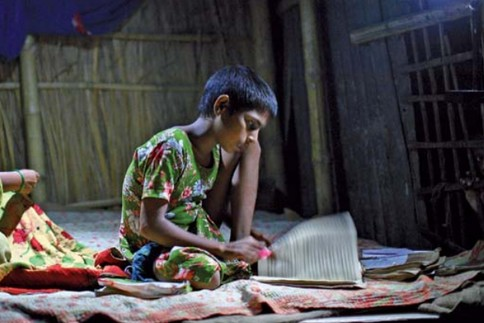 Child studing in low light