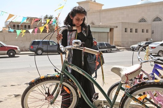 Girl looks at bike
