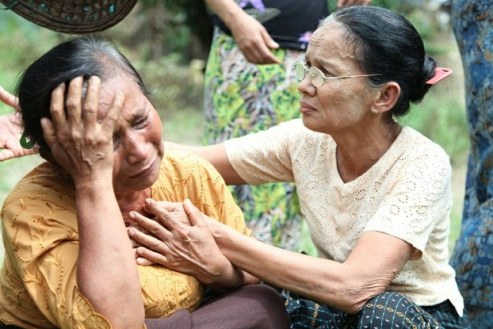 Rohingya Muslim women cry after attack of village