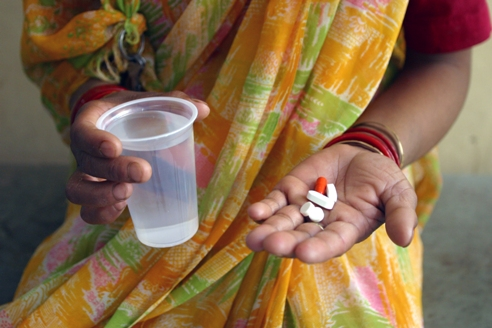 Young girl in Tamil Nadu State, India takes TB meds