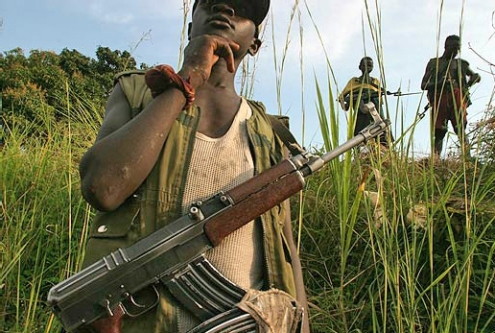 child soldier armed guards in DR Congo