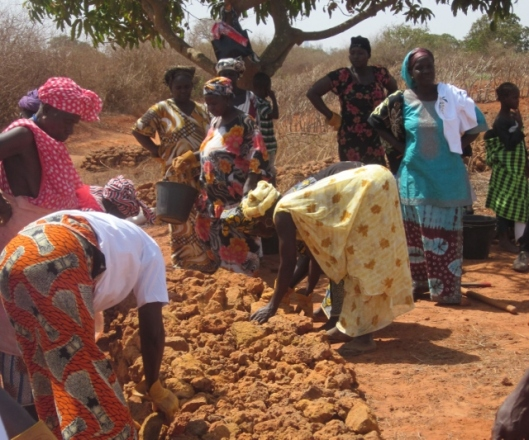 Women cleaning land to prepare for planting