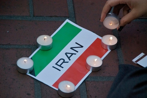 Iran flag banner and candles