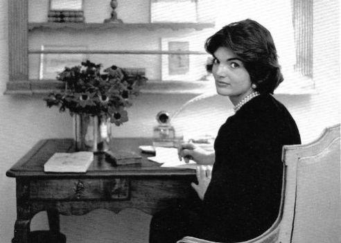Jacqueline Kennedy at her desk at The White House