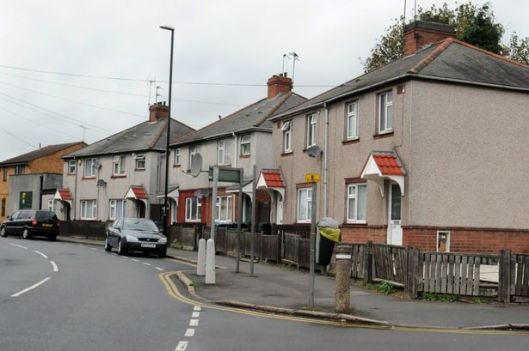 Houses with cars parked in front