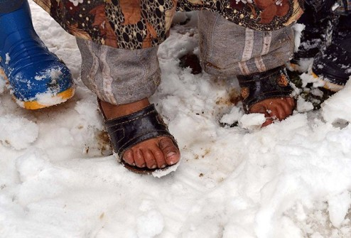 Syrian sandaled feet in snow