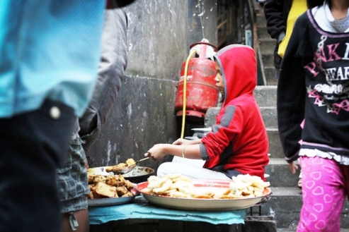 Aizawl, Burma/Myanmar ethnic Chin youth cooks food at market
