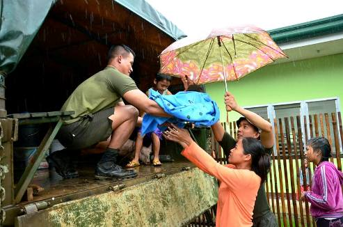 Philippine family recieves local flood relief