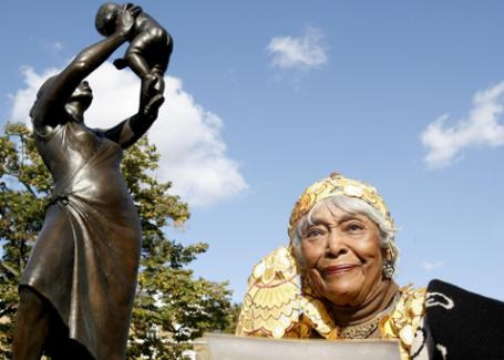 Cecile Nobrega in front of the monument