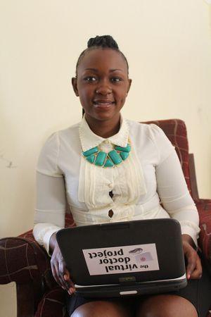 Mercy Nalwamba holding a laptop