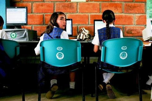 Girl stuidents in computer class Colombia