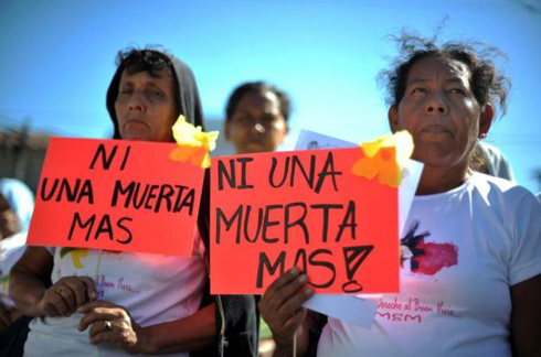 Women with protest signs