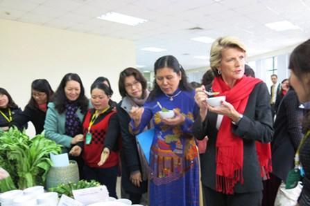Australia's Foreign Minister Julie Bishop tastes a dish