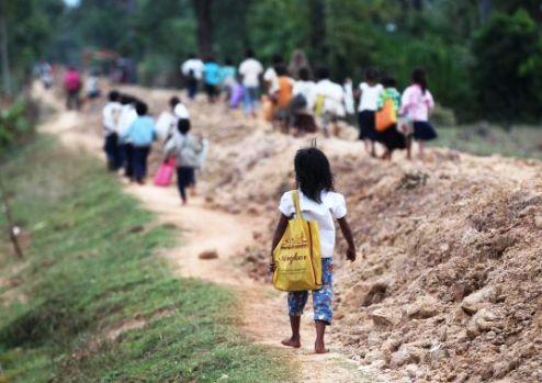 Cambodian children walk to school