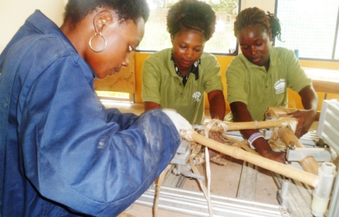 Women making bamboo bikes in Ghana