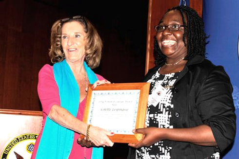 Colette Sespinasse is presented with Woman of Courage plague
