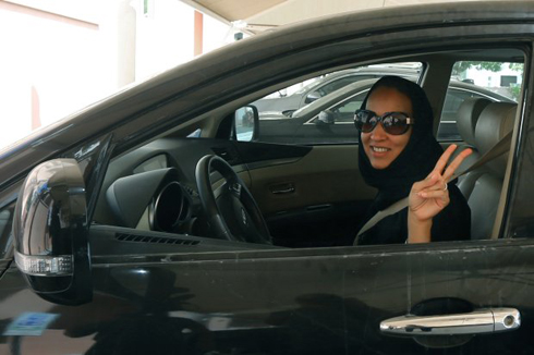 Manal al Sharif in the driver's seat